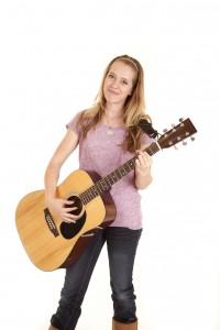 girl playing guitar smile
