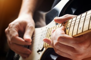 Man playing guitar. Close-up view